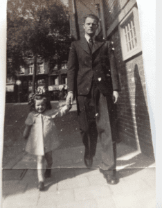 The author walking with her father